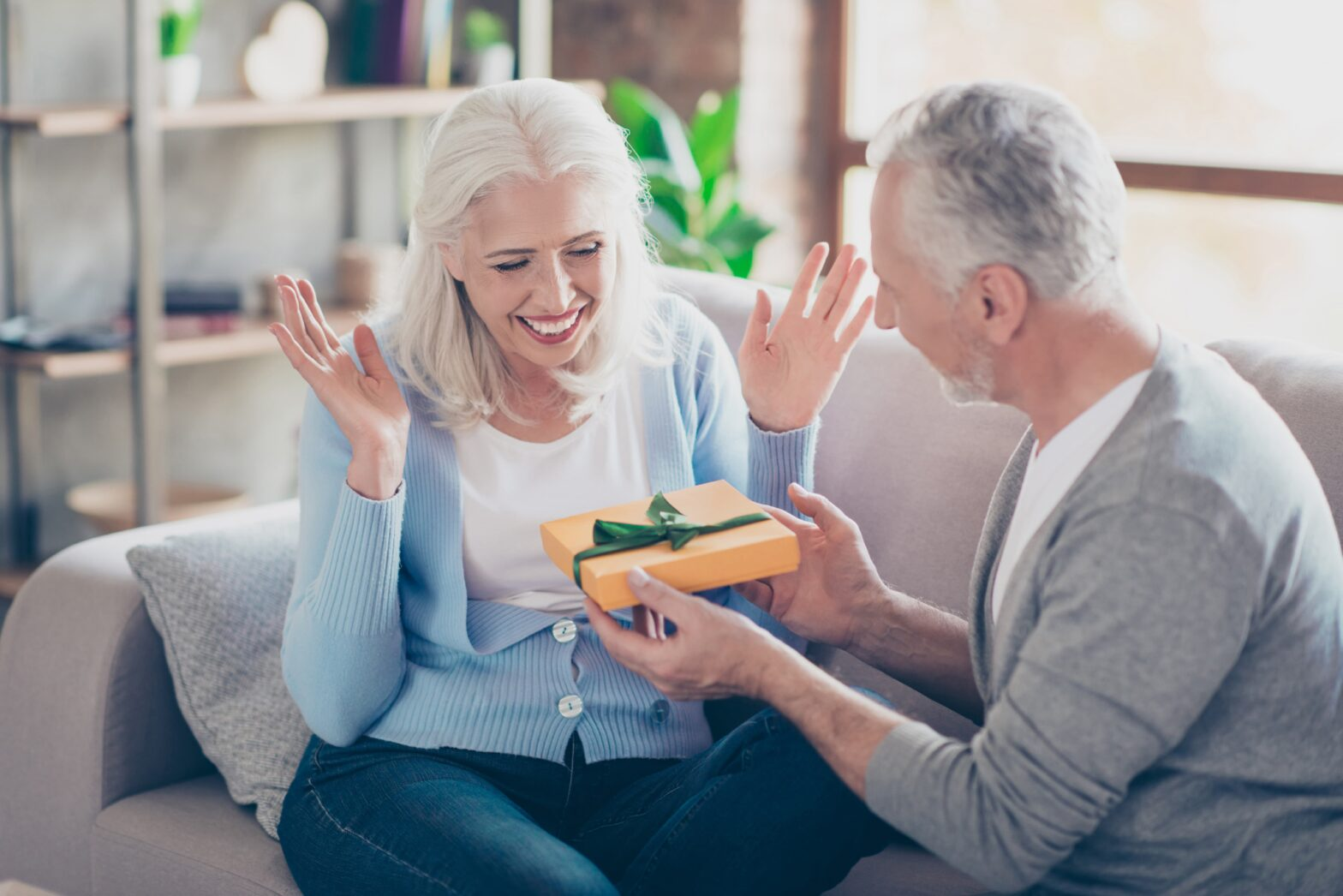 Man giving gift to woman