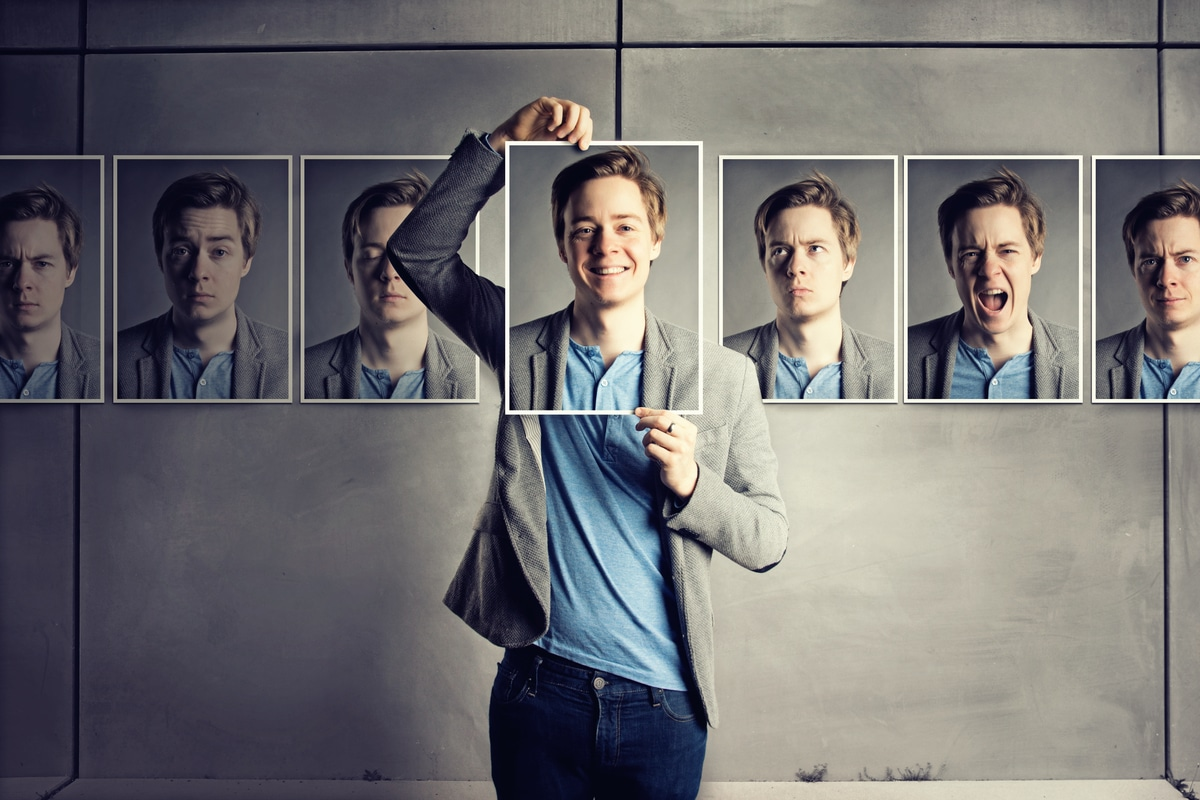 Man with photos of facial expressions