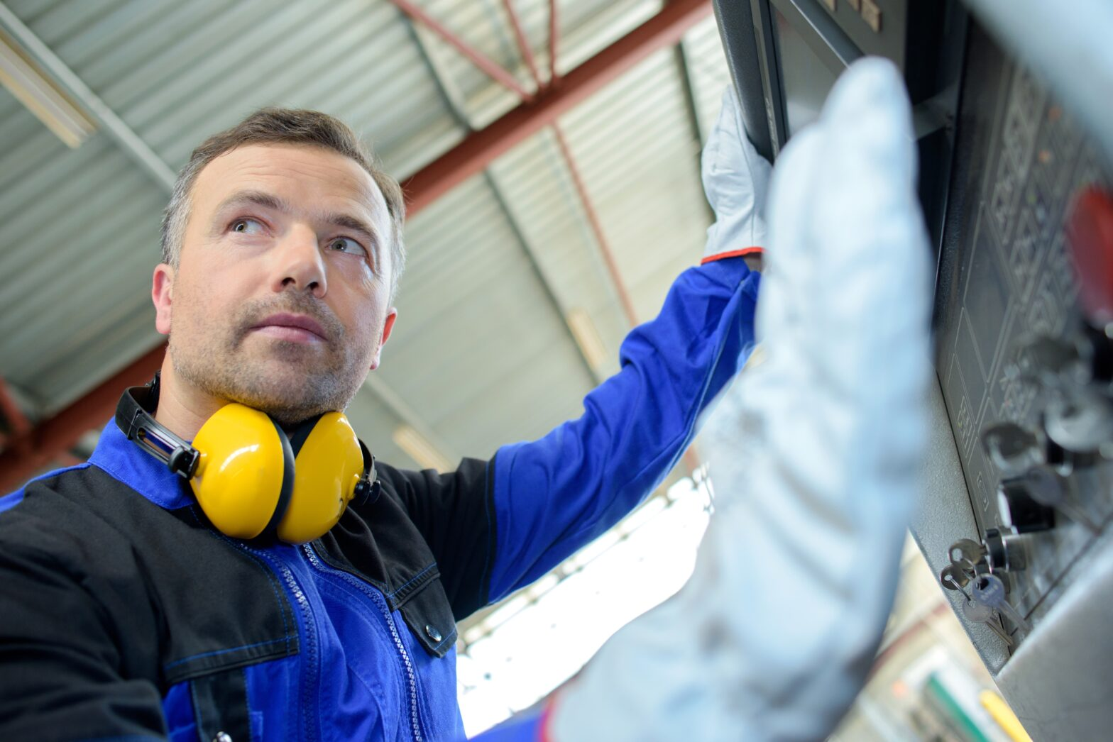Man at work with hearing protection