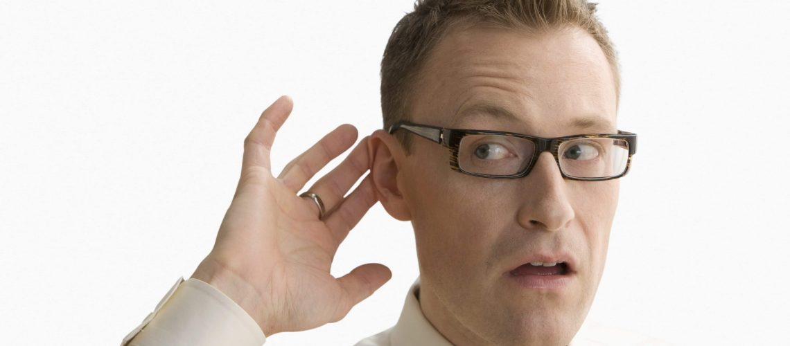 A man with sudden hearing loss trying to hear